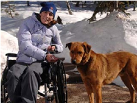 Ultra-runner Danielle Balengee, recovering in her wheelchair after her ordeal, with her faithful friend & savior, Taz the rescue dog!