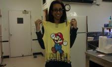 Kila with the T-shirt she created.