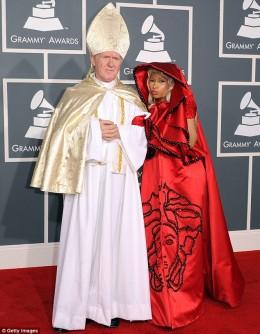 Nicki Minaj with her own clerical arm candy