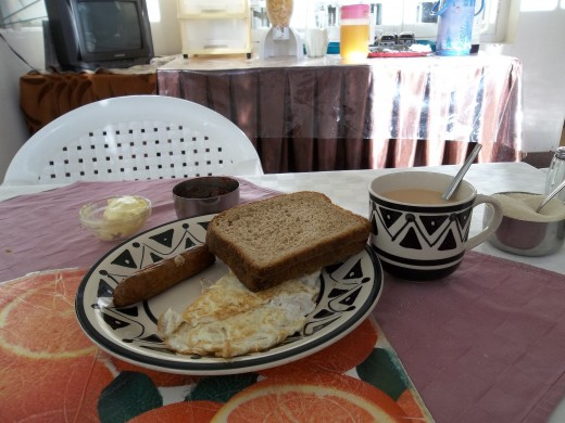 Sausage, egg, toast and hot tea. You can choose to have coffee or milo.