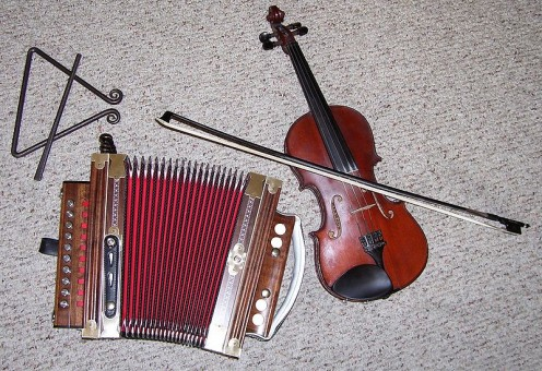 Typical instruments in a Cajun band including the ti-fer triangle