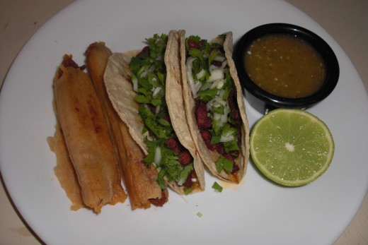 Here are a couple of tacos I preparred recently along with a couple of skillet grilled tamales (grilled in the husks).  Served with chopped cilantro, onion, my tomatillo chile and a lime slice for squeezing over the top!  Delicious!