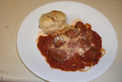 My homemade spaghetti and meatballs with my homemade garlic cathead biscuits!