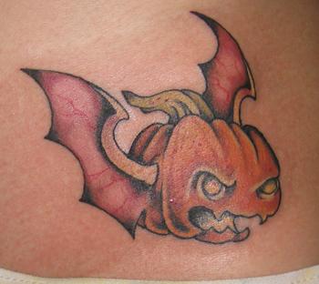 pumpkin tattoo with bat wings