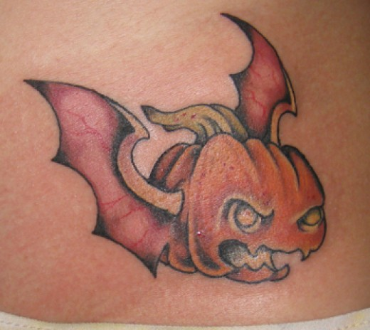 pumpkin tattoo with bat wings