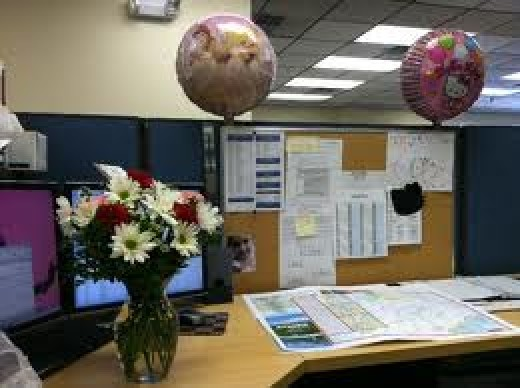 Decorating your work desk with flowers and colours can also improve your mood at work