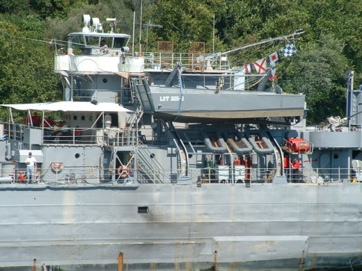 LST-325 has a davit on either side of the deckhouse to faciliate the launch and retrieval of LCVP landing craft.