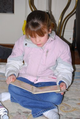young girl enjoying reading
