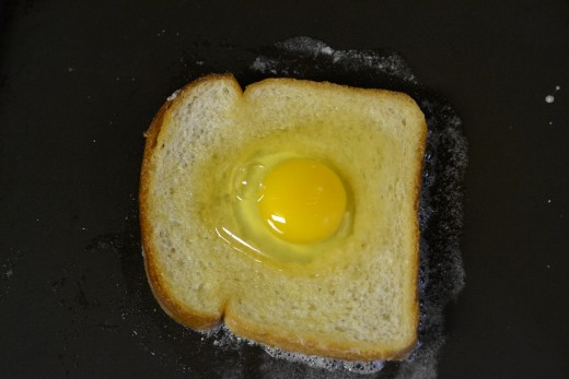 Crack the egg into the bread