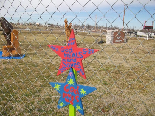 Messages of encouragement made by school children are displayed all over the tornado zone.