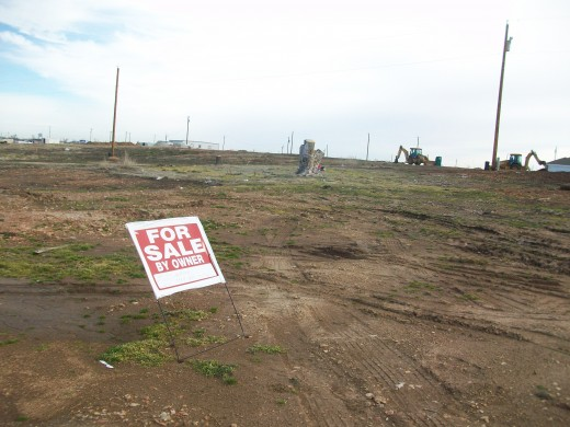 "A ""for sale"" sign reminds of people and families that have moved, and are rebuilding their lives somewhere else."