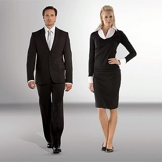 Man and Woman dressed in black suits for the workplace.