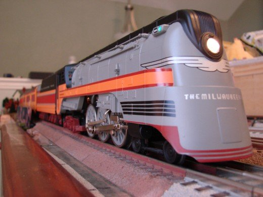 O Scale trains operate on O Gauge track and have varying levels of details