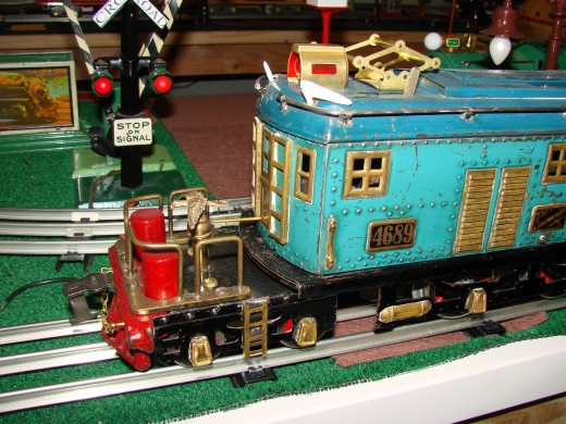 Toy trains are usually not build to scale proportions, and can be brightly colored, like this one from the 1920s