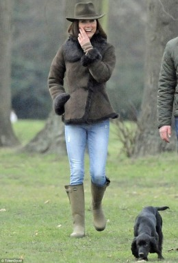 Kate walks her dog Lupo while bodyguard escorts them.