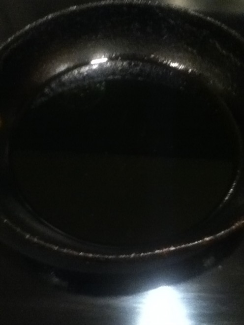 1/2 inch of oil in pan... (to be safe, too little amount of oil does not allow the 'puffing up' to occur