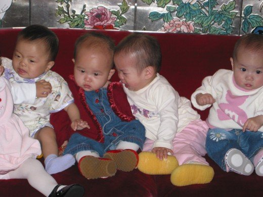China adopted children groups always take a red couch picture at the White Swan hotel. Swan.