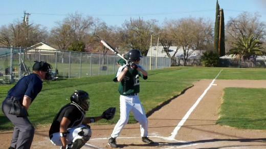 Our son during his first high school at bat