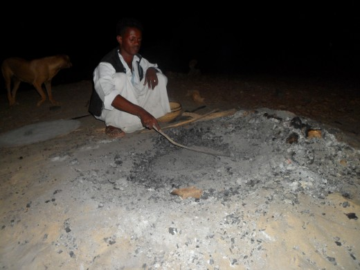 Bread, made right in the sand with hot coals.
