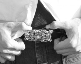 Avoid big or shiny belt buckles like these as they draw a clear line between the upper and lower body.