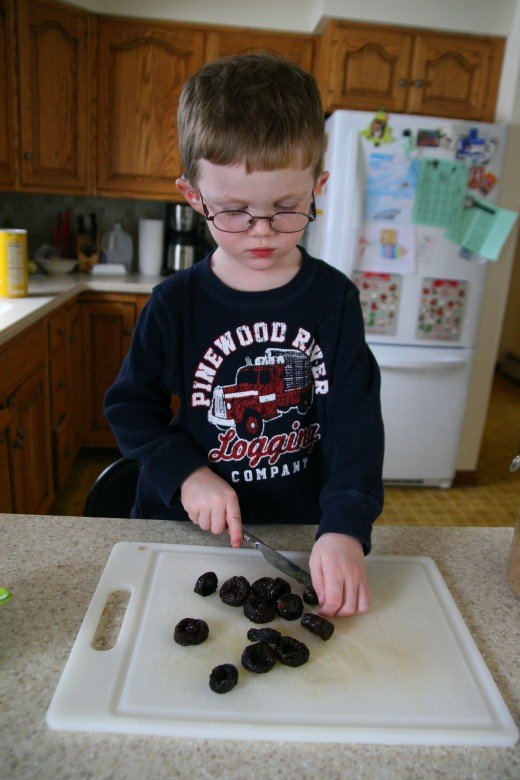 Cutting prunes with a butter knife.