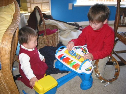 Brother and Sister.  Encourage older siblings by helping them teach their younger ones how to do things.