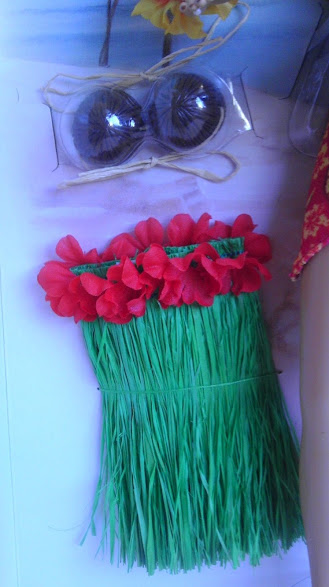 Grass skirt and coconut Barbie bra