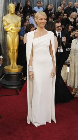 Gwynneth Paltrow in a caped Tom Ford white dress