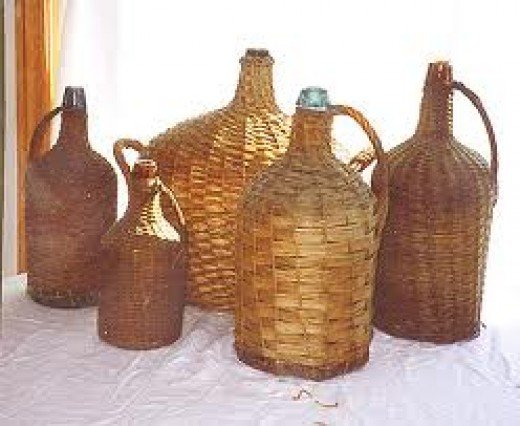 Some demijohns dressed to protect them