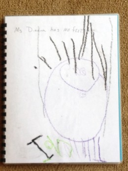 "Large circle for body with sticks representing feet, ""Ms. Dianna has 100 feet"". (four year old drawing)"