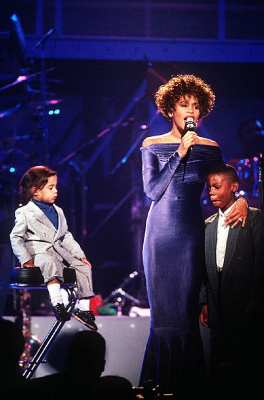 Whitney Houston performing in the early 1990s at a concert for returning Gulf War Troops.