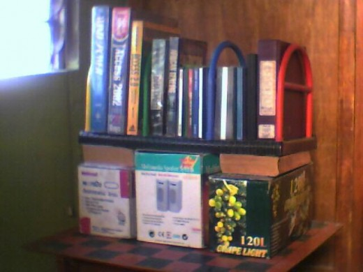 Clockwise from top, the container codes with descriptions are: bookstand    - 3 partitions bookstand, Grape - christmas lights box, JUSTer - speaker box, National    - flat iron box.