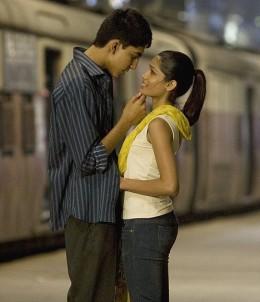 Freida Pinto and co-star boyfriend Dev Patel in a still from Slumdog Millionaire.