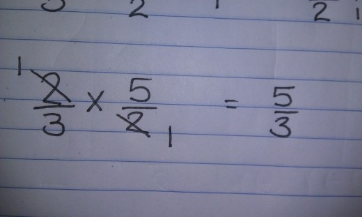 We then multiplication fractions as normal, including any cross canceling.