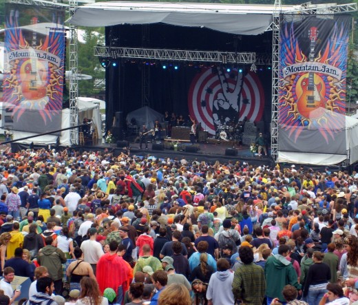 Micheal Franti on stage at Mountain Jam