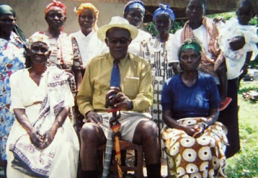 Ancentus Akuku with some of his wives