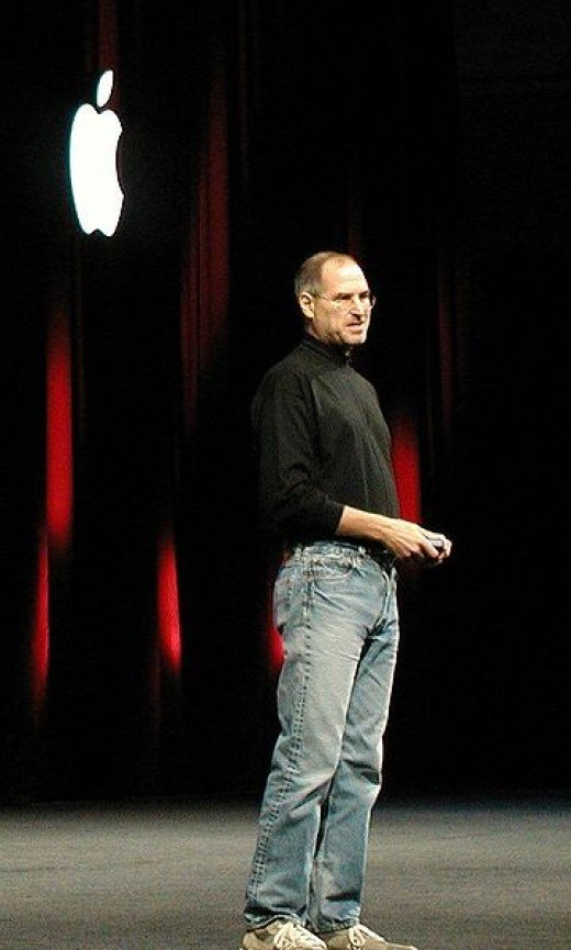 Steve Jobs dressed in his trademark black mock turtle neck and jeans.