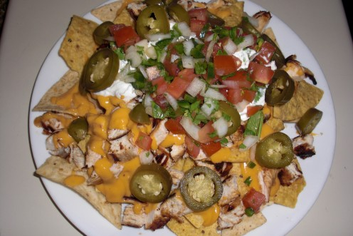 This is a plate of my grilled chicken nachos with sour cream, pico de ...