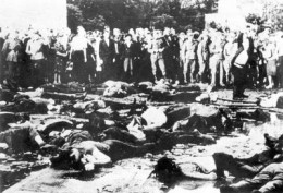 Kaunas, Lithuania, 1941.  German and other spectators view the aftermath of a pogrom the Germans did not have to execute, but did not interfere with, either.
