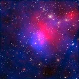 Pandora's Cluster - the sections coloured here in blue represent the invisible dark matter that exists within this group of galaxies.