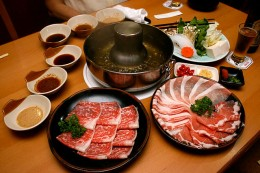 prepared vegetables and meats placed around the Shabu SHabu cook-pot