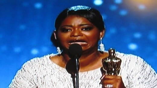Video is shown of Octavia Spencer accepting her Oscar award for Best Supporting Actress.
