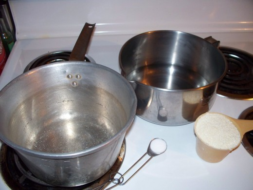 To begin, you will need 4 cups of water, 1 cup of grits, and 1 teaspoon of salt. (I usually omit the salt or cut it in half.)