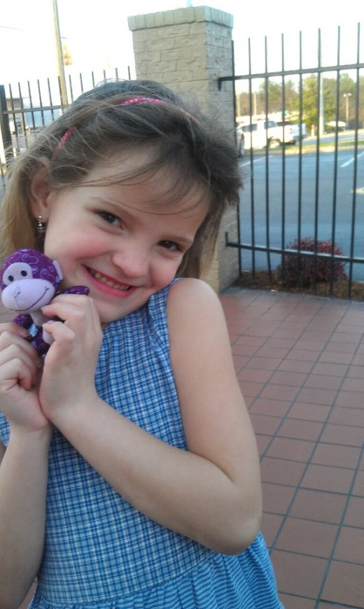 My youngest daughter being oh so cute.  Used her manners while we were at McDonalds.