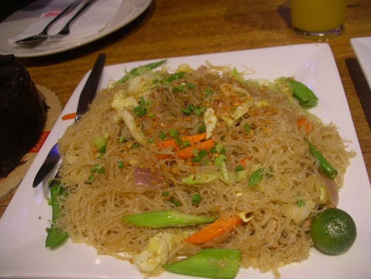 Pansit which is commonly serve on special occassions like birthdays and anniversaries. It is a belief that eating noodles gives you long life.