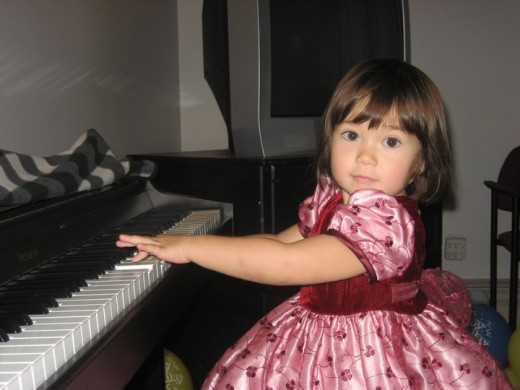 our younger granddaughter on her 3rd birthday... healthy self-worth plays the piano