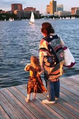 My daughter and I looking out at the Charles River from a dock at the Esplanade