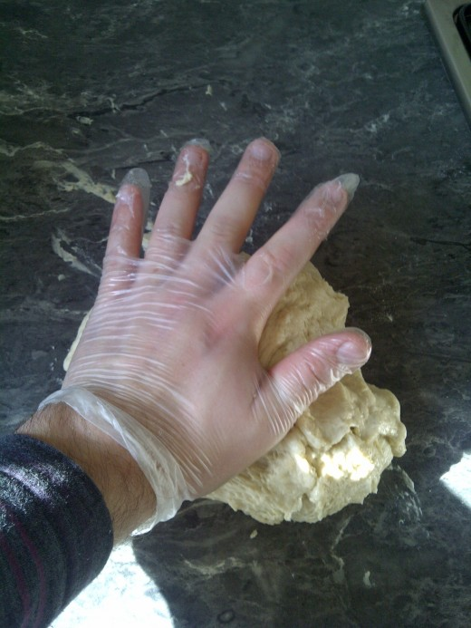 I'm using one hand here (taking the photo with the other) but you can use the other hand to hold the dough in place while you begin to stretch it