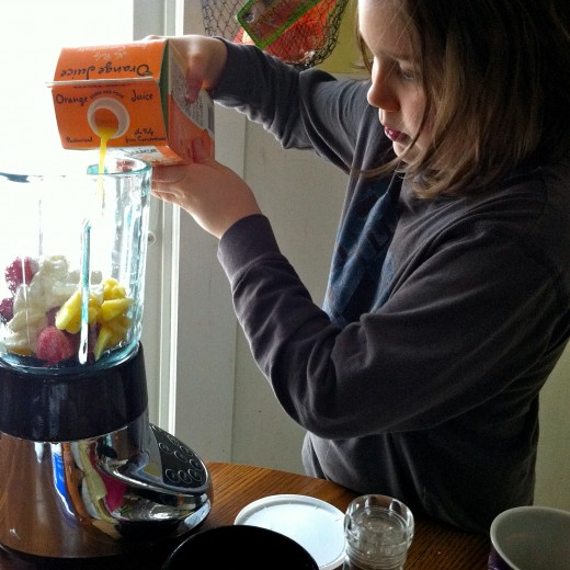 Pouring orange juice into blender