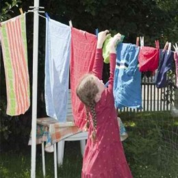 girl hangs out the washing